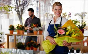 Young woman and client in flowers shop